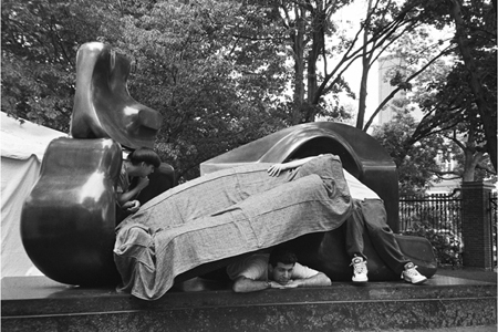 The four of us recline with Henry Moore's sculpture, 'Large Four Piece Reclining Figure'